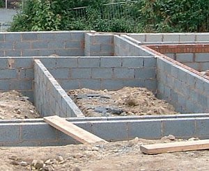 Building home foundation a 1 ultrabuilders construction for Foundation tiny house builders